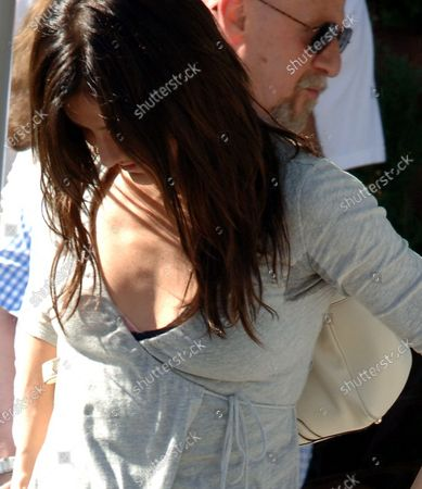 Exclusive - Cameron Diaz who is known for being very fashionable should be well aware that if one is going to wear gray on a hot California afternoon it's good to have a good anti perspirant handy as she has some very visible underarm sweat stains as she meets a girlfriend and gives her a big hug as they meet for lunch at Il Pistaio Restaurant in Beverly Hills, ca The Charlies Angels star was at the restaurant for over 2 hours and stopped to chat with David Katzenberg the son of Shrek Producer Jeffery Katzenberg as she waited for her enviromentally friendly Toyota Prius to be brought by the valet