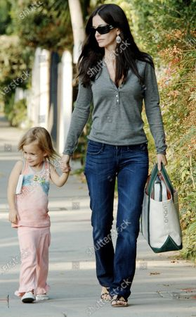 Exclusive - Courtney Cox Arquette and her adorable daughter Coco head to their car after Courtney picked the toddler up from school in Hollywood, Ca