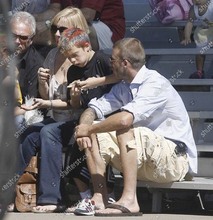 Exclusive - David Beckham spends a sunny Sunday afternoon attending an Annual Fair in Bel Air, Ca with his two sons Brooklyn and Romeo along with his in laws Jackie and Tony Adams. The superstar soccer player seemed to be having a great time as he watched his sons go down a giant slide and chatted with acting legend James Caan