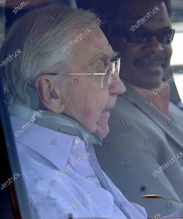 Exclusive - Ed McMahon the popular former sidekick to Johnny Carson on the Tonight Show wears a neck brace after breaking his neck in a fall last year and recovering from two surgeries the 85 year star was enjoying a drink from McDonalds as he was being driven home by an assistant in Beverly Hills, Ca