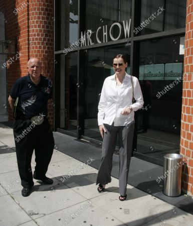Exclusive - Geena Davis chats with legendary publicist Paul Bloch before heading to her car after having lunch at the trendy Mr Chow restaurant in Beverly Hills, Ca