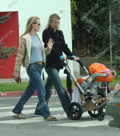 Exclusive - Helen Hunt wearing a T-shirt with a Marijuana Leaf on it spends the day shopping along trendy Montana Avenue in Santa Monica, Ca with her daughter McKenna and her best friend and fellow actress Helen Slater who played Supergirl and starred in the film The Legend Of Billie Jean The two women went to Baby Style where they picked up some items before heading back to the car where they then gave each other a hug and kiss and went their seperate ways