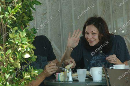 Exclusive - Katherine McPhee waves hello and blows kisses she has lunch at the trendy Urth Cafe in West Hollywood, Ca with boyfriend Nick Cokas  The 22 year old runner up on the popular singing show American Idol and her 41 year old beau seemed to be having a great time as she played with his thinning hair and then they walked with their arms around each other along Melrose Avenue