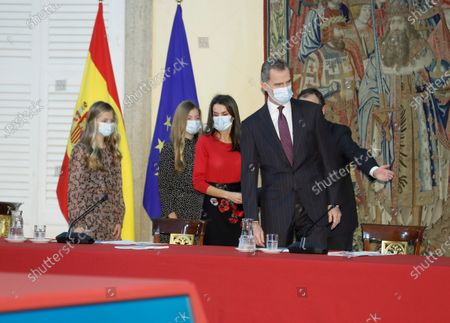 Spain's King Felipe VI (R-L), Queen Letizia, Infanta Sofia and Leonor, Princess of Asturias are about to take their seats prior to chairing the meeting of the patronage of Girona's Princess Foundation at El Pardo palace near Madrid city, central Spain, 11 December 2020. The Prince of Girona Foundation was created in 2009 by a group of Catalan businesspeople and financiers, with the patronage of Felipe, then heir to the throne. Prince/princess of Girona is one of the titles of the Spanish heir apparent. The organisation aims to 'support young people in their professional and personal development' through a number of initiatives, including the prizes, which it awards yearly in five categories: Arts and Letters, Social, Entity, Scientific Research and Business.
