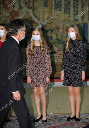 Queen Letizia of Spain (L, back), Leonor, Princess of Asturias (C) and Infanta Sofia (R) receive members of the patronage prior to chairing the meeting of the patronage of Girona's Princess Foundation at El Pardo palace near Madrid city, central Spain, 11 December 2020. The Prince of Girona Foundation was created in 2009 by a group of Catalan businesspeople and financiers, with the patronage of Felipe, then heir to the throne. Prince/princess of Girona is one of the titles of the Spanish heir apparent. The organisation aims to 'support young people in their professional and personal development' through a number of initiatives, including the prizes, which it awards yearly in five categories: Arts and Letters, Social, Entity, Scientific Research and Business.