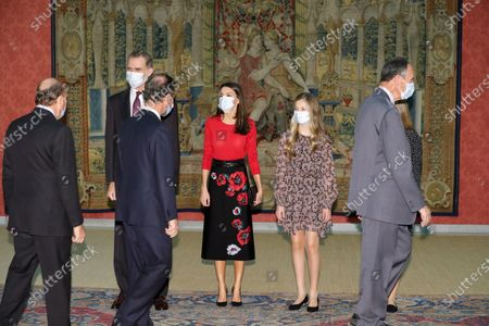 Spain's King Felipe VI (L-R, back), Queen Letizia, Leonor, Princess of Asturias and Infanta Sofia receive members of the patronage prior to chairing the meeting of the patronage of Girona's Princess Foundation at El Pardo palace near Madrid city, central Spain, 11 December 2020. The Prince of Girona Foundation was created in 2009 by a group of Catalan businesspeople and financiers, with the patronage of Felipe, then heir to the throne. Prince/princess of Girona is one of the titles of the Spanish heir apparent. The organisation aims to 'support young people in their professional and personal development' through a number of initiatives, including the prizes, which it awards yearly in five categories: Arts and Letters, Social, Entity, Scientific Research and Business.