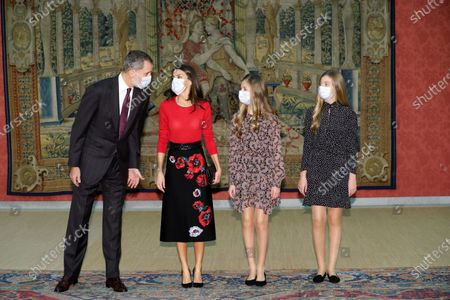 Spain's King Felipe VI (L-R), Queen Letizia, Leonor, Princess of Asturias and Infanta Sofia pose prior to chairing the meeting of the patronage of Girona's Princess Foundation at El Pardo palace near Madrid city, central Spain, 11 December 2020. The Prince of Girona Foundation was created in 2009 by a group of Catalan businesspeople and financiers, with the patronage of Felipe, then heir to the throne. Prince/princess of Girona is one of the titles of the Spanish heir apparent. The organisation aims to 'support young people in their professional and personal development' through a number of initiatives, including the prizes, which it awards yearly in five categories: Arts and Letters, Social, Entity, Scientific Research and Business.