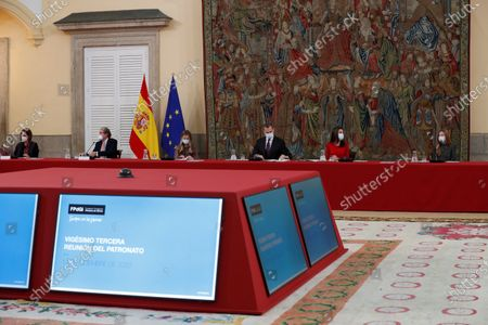Spain's King Felipe VI (3rd-R), Queen Letizia (2nd-R), Asturias' Princess Leonor (4th-R) and infanta Sofia (R) chair the meeting of the patronage of Girona's Princess Foundation at El Pardo palace near Madrid city, central Spain, 11 December 2020. The Prince of Girona Foundation was created in 2009 by a group of Catalan businesspeople and financiers, with the patronage of Felipe, then heir to the throne. Prince/princess of Girona is one of the titles of the Spanish heir apparent. The organisation aims to 'support young people in their professional and personal development' through a number of initiatives, including the prizes, which it awards yearly in five categories: Arts and Letters, Social, Entity, Scientific Research and Business.