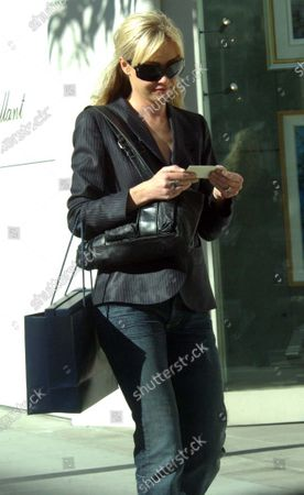 Exclusive - Portia Di Rossi who is best known to audiences as Nell on Ally MacBeal and now stars on the hit comedy show Arrested Development strolls along Rodeo Drive in Beverly Hills, Ca where she stopped into the Channel store before then going to Ralph Lauren and picking up some items