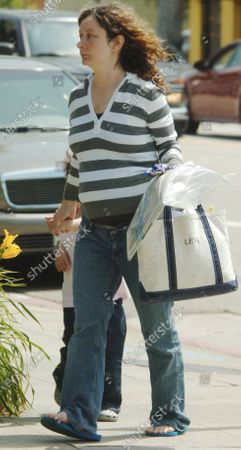 Exclusive - Sara Gilbert who played Darlene Conner on the television series Roseanne looking very pregnant takes her young son Levi to the Pediatrician's office in Santa Monica, Ca this will be the 1st biological child for Sara who is in  relationship with producer Allison Adler who gave birth to Levi via a sperm donot