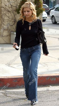 """Exclusive - Actress Sarah Michelle Gellar spends a quiet afternoon shopping along trendy Robertson Blvd in Beverly Hills, Ca with a female friend. The actress who rose to fame on """"Buffy The Vampire Slayer"""" can now been seen in theaters reprising her role as the sexy """"Daphne"""" in """"Scooby Doo 2: Monsters Unleashed"""" which also stars her husband Freddy Prinze Jr."""