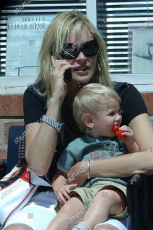 Exclusive - Sharon Stone with her young son Laird Vonne Stone out and about in Beverly Hills, Ca the Basic Instinct star took her boy to the Dr's office before sitting down on bench along Bedford Drive and managing to keep a handle on the boy and chat on her cell phone at the same time and then headed off back to the parkinng lot where her car was