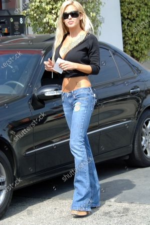 Stock Photo of Exclusive - Shauna Sands has her car checked out while at a gas station in Beverly Hills, Ca the Playboy model and former wife of actor Lorenzo Lamas was alos displaying a very wrinkled midsection
