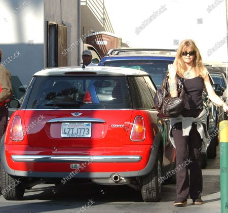 """Actress Goldie Hawn heads to her friends Mini-Cooper after having lunch at """"Chaya Brasserie"""" in Beverly Hills, Ca around the corner from """"Cedars Sinai"""" hospital where daughter Kate Hudson gave birth to her 1st child and Goldie's 1st grandchild Ryder Russell Robinson the day before. The Academy award winning actress had just come from taking Kate some food from """"Jerry's Famous Deli"""""""
