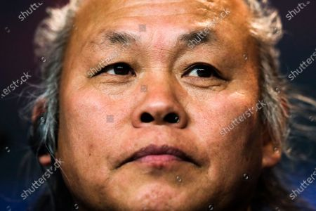 Director Kim Ki-duk attends a news conference during the 68th edition of the International Film Festival Berlin, Berlinale, in Berlin, Germany. South Korean director Kim Ki-duk who won the top award at the Venice Film Festival in 2012 and later faced allegations of trying to force an actress into shooting off-script sexual scenes while making another movie, has died in Latvia. He was 59. The Baltic News Service said Kim passed away Friday, Dec. 11, 2020 after falling ill with Covid-19