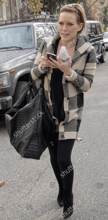Hillary Duff clutches her cellphone and a bottle of water as she heads to the hair dresser in Beverly Hills, Ca