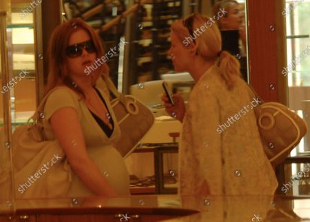 Australian Actresses Isla Fisher who is heavily pregnant with her 1st child with Borat star Sacha Baron Cohen and Naomi Watts who just had a baby with fiance Liev Schreiber two weeks ago meet up at Barney's of New York in Beverly Hills, Ca