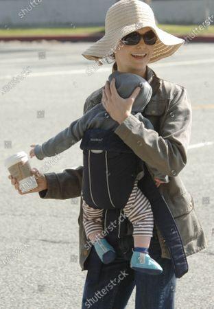 Stock Picture of Actress Keri Russell takes her young son River Russell Deary on a morning walk and starbucks run along Montana Avenue in Santa Monica, Ca the little one seemed to be attempting to get his caffeine fix early in life as he appeared to be reaching for moms cup of coffee