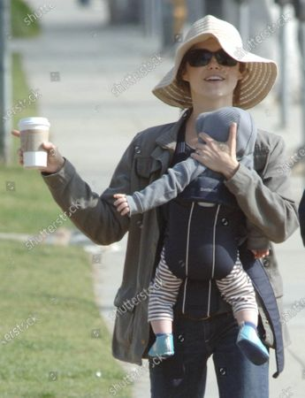 Actress Keri Russell takes her young son River Russell Deary on a morning walk and starbucks run along Montana Avenue in Santa Monica, Ca the little one seemed to be attempting to get his caffeine fix early in life as he appeared to be reaching for moms cup of coffee