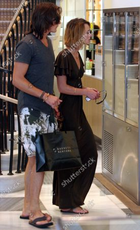 Keira Knightley shops at the trendy Barney's Of New York in Beverly Hills, ca with her boyfriend actor Rupert Friend and her mother Sharmian MacDonald