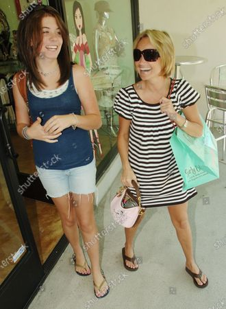 Kristin Chenowith who is starring in the new television series Pushing Daises goes shopping at the fashionable Surly Girl store along Robertson Boulevard in Beverly Hills, ca with her friend Chloe Sonnenfeld who is the daughter of director Barry Sonnenfeld who is producing her tv show and Chole played Kristin's daughter in the movie RV