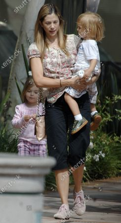 Mira Sorvino's young son does not seem to be too happy as she along with her daughter and husband Chris Backus head to lunch at Toscana Restaurant in Brentwood, ca maybe he would much rather go to Chuk E Cheese then an upscale Italian eaterie
