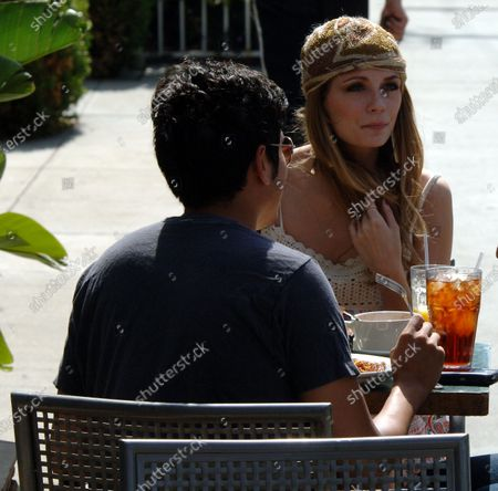 Mischa Barton looking very Boho chic as she heads to her car with her new puppy and a copy of the novel Dry by Augusten Burroughs the author of Running With Scissors after having lunch at the popular Le Converssation Restaurant in West Hollywood, Ca