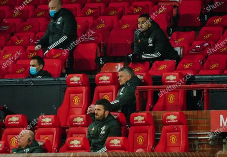 Manchester United manager Ole Gunnar Solskjaer sits in the dugout near assistant coach Michael Carrick