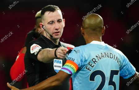 Referee Chris Kavanagh points to the penalty spot before a VAR check ruled that Marcus Rashford of Manchester United was offside