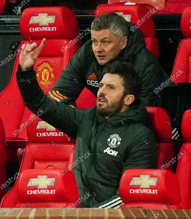 Coach-Ole Gunnar Solskjaer of Manchester United behind coach Michael Carrick