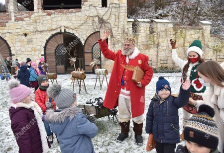 An actor dressed like St. Nicholas talks to children. The tradition of Saint Nicholas Day is a festival for children in most Orthodox countries in Europe related to surviving legends of Saint Nicholas, and particularly his reputation as a bringer of gifts.