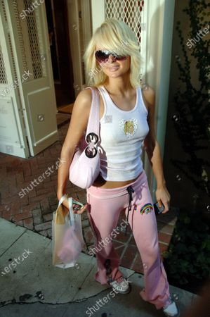 Paris Hilton is all smiles as she heads to her car after getting her hair cut washed and blow dryed by Sally Hershberger at John Frieda salon in West Hollywood, Ca