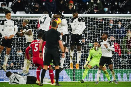 Referee Andre Marriner awards Liverpool a penalty for handball by Aboubakar Kamara of Fulham from a free kick taken by Georginio Wijnaldum of Liverpool