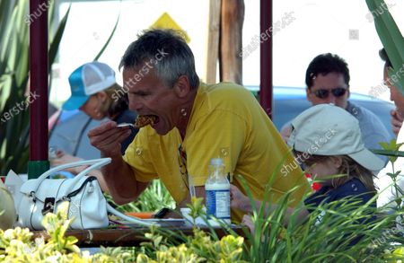 Actor Richard Dean Anderson who played MacGyver on the hit television series and now stars on Stargate SG-1 spends the 4th of July Holiday weekend with his daughter playing frisbee and having lunch in Malibu, Ca