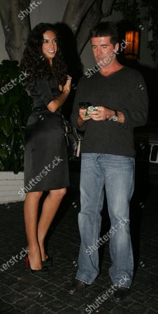 Simon Cowell and girlfriend Teri Seymour wait for their car after leaving the Chateau Marmont Hotel in West Hollywood, Ca