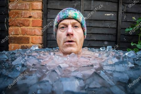 Outdoor swimmer John Myatt is spending 15 minutes a day in a bath of ice at his home in Gloucestershire with temperatures down as low as 2 degrees. Pic by Brad Wakefield 8th December 2020.John has been feeling the consequences of Covid-19  impacting on his training and like many out there trains for mental health reasons.