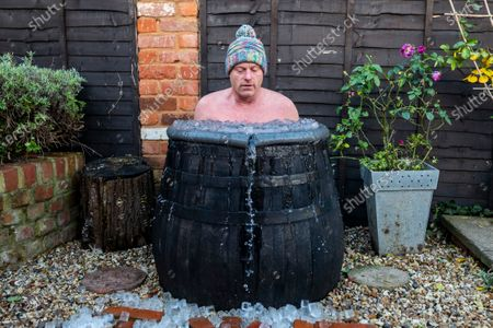 Stock Picture of Outdoor swimmer John Myatt is spending 15 minutes a day in a bath of ice at his home in Gloucestershire with temperatures down as low as 2 degrees. Pic by Brad Wakefield 8th December 2020.John has been feeling the consequences of Covid-19  impacting on his training and like many out there trains for mental health reasons.