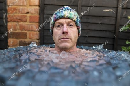 Stock Image of Outdoor swimmer John Myatt is spending 15 minutes a day in a bath of ice at his home in Gloucestershire with temperatures down as low as 2 degrees. Pic by Brad Wakefield 8th December 2020.John has been feeling the consequences of Covid-19  impacting on his training and like many out there trains for mental health reasons.
