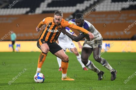 Tom Eaves of Hull City battles with Aaron Pierre of Shewsbury Town