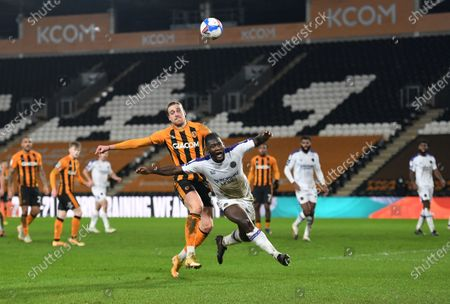 Tom Eaves of Hull City and Aaron Pierre of Shewsbury Town
