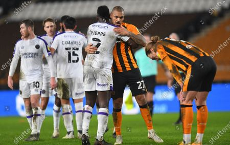 Aaron Pierre of Shrewsbury Town and Josh Magennis of Hull City at full time