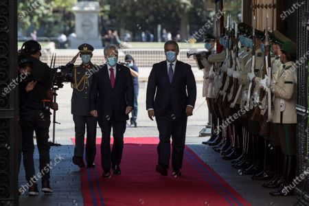 The President of Chile, Sebastian Pinera (L), receives his Colombian counterpart, Ivan Duque (R), at the Palacio de La Moneda in Santiago, Chile, 11 December 2020. Duque arrived in Santiago to assume the pro tempore presidency of the Pacific Alliance on Friday, and on Saturday that of the Forum for the Progress of South America (Prosur), which he will receive from his Chilean counterpart, Sebastian Pinera, official sources reported.