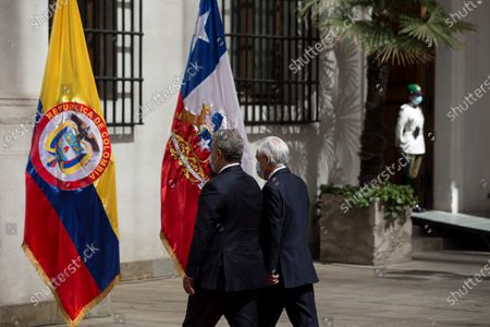The President of Chile, Sebastian Pinera (C), receives his Colombian counterpart, Ivan Duque (L), at the Palacio de La Moneda in Santiago, Chile, 11 December 2020. Duque arrived in Santiago to assume the pro tempore presidency of the Pacific Alliance on Friday, and on Saturday that of the Forum for the Progress of South America (Prosur), which he will receive from his Chilean counterpart, Sebastian Pinera, official sources reported.
