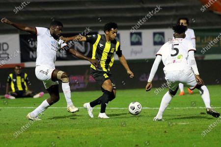 Al-Shabab's players Hassan Altambakti (R) and Alfred N'Diaye (L) in action againt Al-Ittihad's Romarinho (C) during the Saudi Professional League soccer match between Al-Shabab and Al-Ittihad at Prince Khalid bin Sultan Stadium, in Riyadh, Saudi Arabia, 11 December 2020.