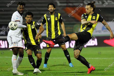 Al-Shabab's player Hassan Altambakti (L) in action againt Al-Ittihad's Aleksandar Prijovic (R) during the Saudi Professional League soccer match between Al-Shabab and Al-Ittihad at Prince Khalid bin Sultan Stadium, in Riyadh, Saudi Arabia, 11 December 2020.