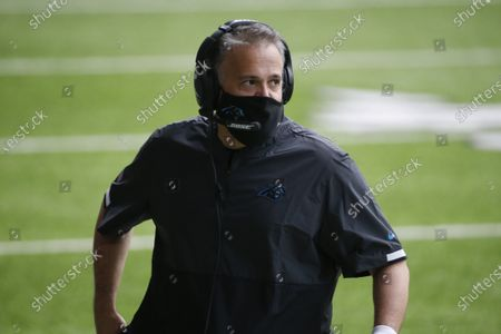 Carolina Panthers head coach Matt Rhule watches from the sideline during the first half of an NFL football game against the Minnesota Vikings in Minneapolis. Rhule built a winner at Temple, then re-energized a Baylor program that was scandal-ridden. He came to a Panthers team in rebuilding mode, and while they're just 4-8, probably their two best players _ RB Christian McCaffrey and DL Kawann Short _ have been injured