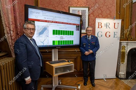 Brugge mayor Dirk De Fauw and Brugge police chief Dirk Van Nuffel pictured during the presentation of the 'druktebarometer', an online barometer to measure the crowd in the city center of Brugge, Friday 11 December 2020.