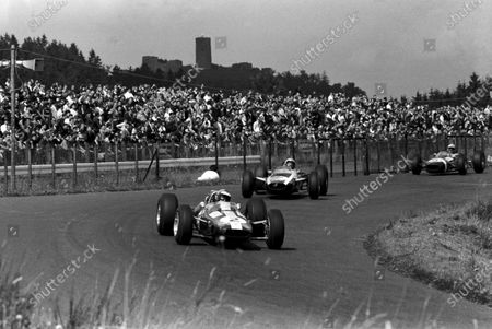 Stock Photo of Mike Spence (GBR) Lotus 33 retired on the ninth lap with a broken drive shaft.  German Grand Prix, Nurburgring, 1 August 1965.