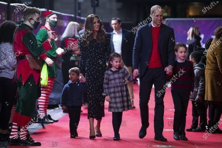 Britain's Prince William and Kate, The Duke and Duchess of Cambridge and their children, Prince Louis, left, Princess Charlotte and Prince George arrive for a special pantomime performance at London's Palladium Theatre, hosted by The National Lottery, to thank key workers and their families for their efforts throughout the COVID-19 pandemic