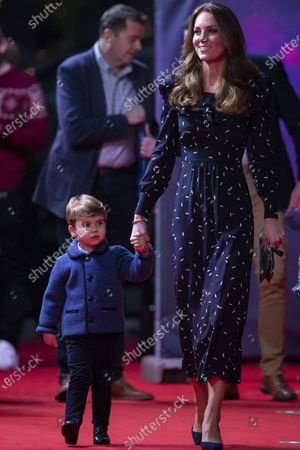 Britain's Kate, the Duchess of Cambridge and Prince Louis arrive for a special pantomime performance at London's Palladium Theatre, hosted by The National Lottery, to thank key workers and their families for their efforts throughout the COVID-19 pandemic